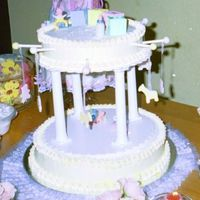 My 1St Baby Shower Cake-A Baby Mobile This cake was done for my niece Clarissa. It is hard to see the colors of the cake and detail because of the flash. Both tiers are 2 layers...