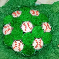 Baseball Theme Cupcake Bouquet Made this last year for my husband's birthday. He's a baseball guy and I really wanted to try a cupcake bouquet a different want...