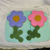Flower Cupcake Cake The flowers are made out of regular size cupcakes and the stems are mini cupcakes! Fun to do :-)