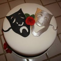 Drama & Comedy Mask This cake was for a murder mystery fundraiser. The cake is covered in fondant and the masks were fondant as well. Thanks for looking!
