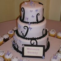 "Purple Butterfly Cake  This cake was for a baby shower. 12"", 9"" & 6"" vanilla rum cakes covered in fondant. Gumpaste butterflies and fondant..."