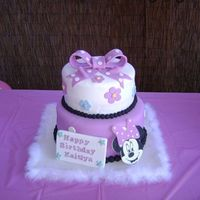 Minnie Mouse Cake  Color on the picture came out a little purple, the actual color was more pink. Vanilla rum cake covered in fondant. Gumpaste and fondant...