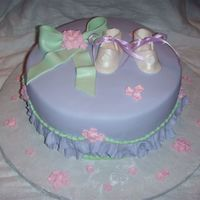 Baby Shower WASC cake with Satin Ice fondant ruffles and booties/bow
