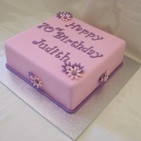 Pink Birthday Square 10 inch caramel mud cake covered in pink fondx