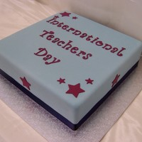 International Teachers Day 12 inch square mud cake covered in blue fondx - to match school colours to celebrate international teachers day