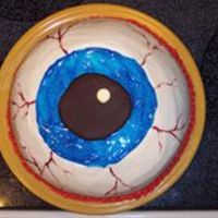 Eyeball Cake  I made this cake for my duaghter's Mad Scientist Halloween party for school. It was a big hit! Yellow cake with strawberry filling....