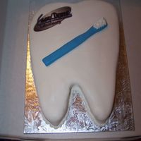 Tooth Cake This cake was made for a dental lab. Edible image and a fondant tooth brush.