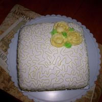 Yellow Rose Lemon cake with fondant, yellow roses and cornelli lace.