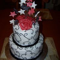 60Th Birthday Cake Red velvet cake with cream cheese icing and swiss choclate cake with pudding filling. Fondant stars and chocolate clay roses.