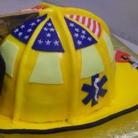 Friestatt Firefighter Helmet Replica of a Friestatt Missouri Firefighters helmet. 8 inch cakes cut to ressemble a carines 1010 helmet, complete with gumpaste ribs...