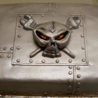 Skull Cake Sheet cake covered with fondant, sprayed with Nu-Silver. Skull with glarring eyes is fondant.