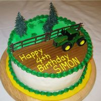 "John Deere Tractor Cake   10"" round, all buttercream decoration with plastic cake toppers. The child wanted a toy he could play with after he ate the cake!"