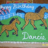 "Horse & Foal 1/4 sheet decorated in buttercream. Little girl wanted ""Mommy and baby horse to look like Spirit."""