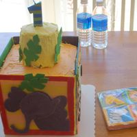 "Wyatt's 1St Birthday Cake! Block cake - 4 8"" square cakes stacked. Iced in buttercream with fondant panels on the side. Top is 2 4"" round cakes stacked,..."