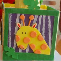 "Giraffe Side Of Wyatt's 1St Birthday Cake Block cake - 4 8"" square cakes stacked, iced in buttercream with fondant panels. Top cake is 2 4"" cakes stacked, iced in..."