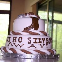 Hi Ho Silvers Away This cake is for a wedding shower. The bride is marrying a man with the last name Silver and apparently likes western gear. This cake was...