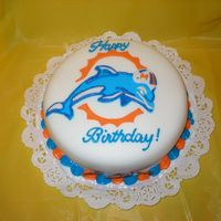 Miami Dolphins White cake with strawberry filling details made out of fondant.