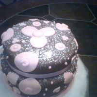 4Th Cake Good Learning Experience Chocolate fondant marbled with Pink. It really did not turn out. Learned a lot though!!