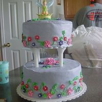 Tinker Bell   My first try at a tier cake. Made it for niece bc icing with royal icing flowers