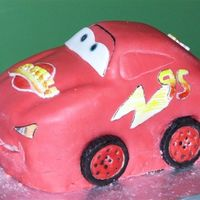 Mcqueen Side View fondant over carved cake, painted details.