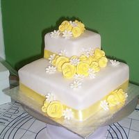 "My First Wedding Cake!  fondant over buttercream, lemon b/c between layers, 4"" and 8"" squares, client bought the roses and daisies cuz I chickened out on..."