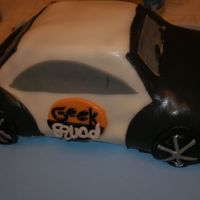 Geek Squad Car Birthday cake for my brother in law - a self proclaimed computer geek. Cake is Wilton car pan covered in fondant and tinted chocolate...
