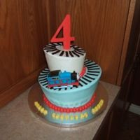 Whimsical Thomas Cake Little boy LOVES Thomas, last year I did a 3D cake of Thomas for him and this year had ot come up with different Thomas idea, so this is...