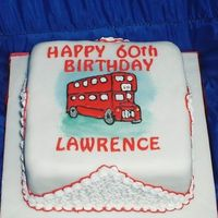 60Th Birthday Fruit cake covered in marzipan and fondant. The bus is a royal icing run out and there is filigree work on the sides