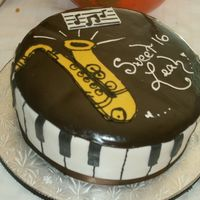 Piano Sax Cake i made this for my younger sisters birthday she plays the piano and the sax