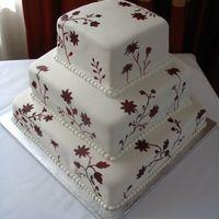 Wedding Cake Hand painted flowers on fondant icing.