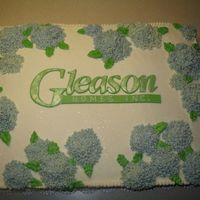 Hydrangea Cake   This was a sheet cake for an open house. The name was cut out of fondant, and the hydrangeas are made out of butter cream