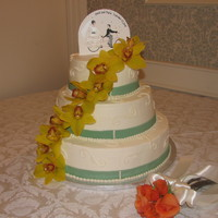 Simple Wedding Cake  This is a white cake with a strawberry and custard filling covered in buttercream. The flowers are real, the ribbon is fondant, and the...