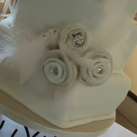 Textured Hexagon Cake   3 tier fondant hexagon cake. Fondant flowers matched the brides dress.