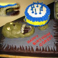 Zombie Cake Zombie cake that I made for my sons 8th birthday. I wanted it to look like the zombie was handing my son a cake. It is 2 9 X 13 marble...