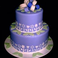 Spring Theme Cake  MMF covered cake with MMF decorations. The cake is actually purple with light and dark purple and white loops but the camera made it look...