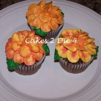 Flower Power Chocolate cupcakes decorated to look like a flower using fall colors.