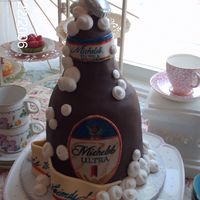Grooms Cake   Its way to fat for a beer bottle.........hand carved # cake covered in chocolate wrap and hand painted label,RI bubbles.