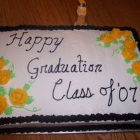 Graduation Cake   I don't have very much practice at making flowers, but I thought these weren't too bad.