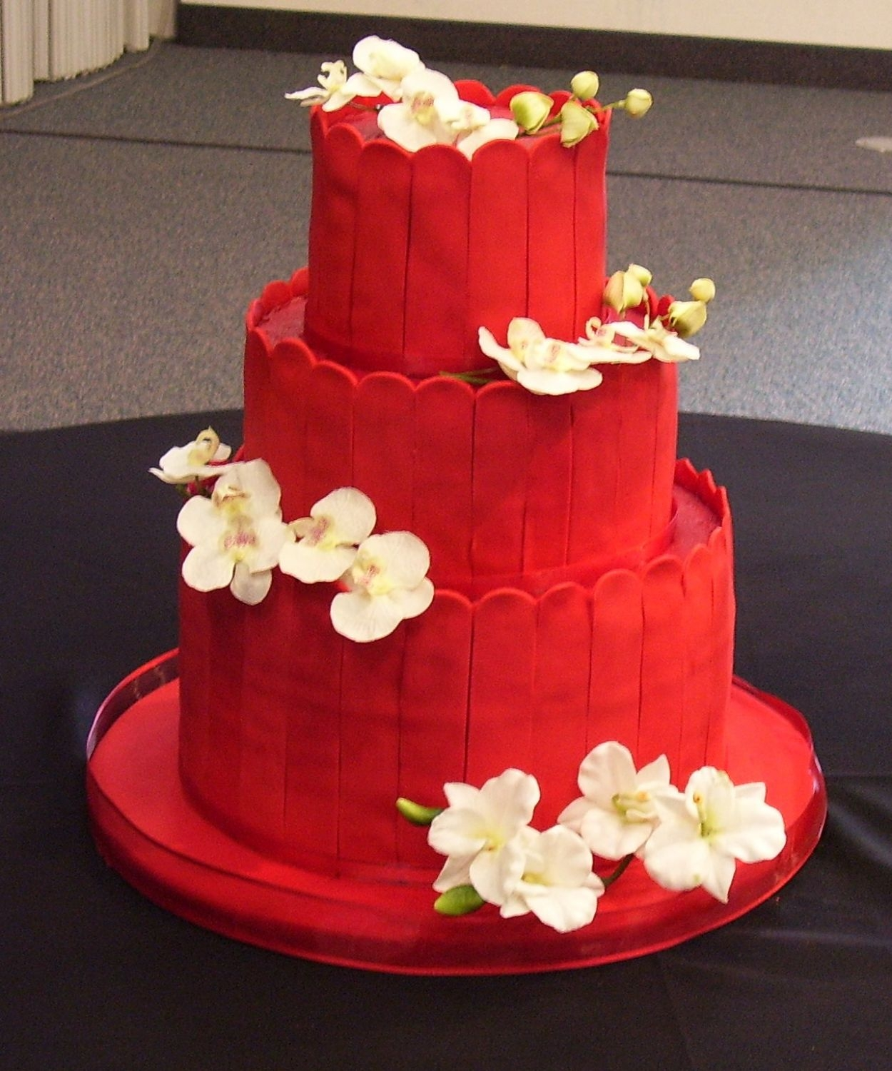 Red Asian Themed Wedding This is a very red cake! Lots and lots of food color! Frosted red with red satin ice slats around the layers. This is my first real wedding...