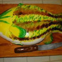 Fish Cake This is covered with marshmallow fondant. The cake board is also covered in fondant to look like a cutting board. I also made the knife...