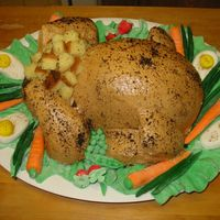Turkey Cake All of the vegtables are made with marshmallow fondant. The cake is iced with crusting buttercream and sprayed with liquid brown sugar.