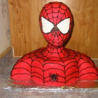 Spiderman This cake is white cake with buttercream frosting. The head is a wig head.