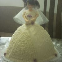 Bride Doll  Made with the wondermold pan and fake little flowers just to add some color. Made ths for my friend's shower and everyone was so...