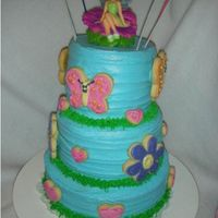 "Tara's Butterflies, Flowers & Hearts  A repeat request from my 6yo. This was a cake I made for her when she celebrated four. A variation of Wilton's 2004 ""Spreading..."
