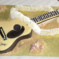 "Jimmy Buffett Guitar Cake board is 20"" x 30"" and the entire guitar is cake/fondant with the exception of the silver metallic embroidery thread strings..."