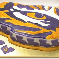 Lsu Eye Of The Tiger I hand carved this from a 12 x 18, covered it in fondant and then hand painted it.
