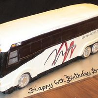 Tour Bus This cake was huge - almost three feet long, a foot tall and about 6 inches wide. It is all cake and is iced in butter cream with fondant...
