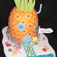 Spongebob's Pineapple Under The Sea SPONGEBOB CAKE FOR MY DAUGTHER'S BIRTHDAY. THE SPONGEBOB HIMSELF IS PLASTIC. THE FLOWERS AROUND THE BASE OF THE HOUSE ARE MADE CANDY...