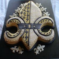 Black And Gold Fleur De Lis This was a groom cake for a couple who are big Saints fans. Hand carved - very hard to cover in fondant!!!!!