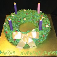 "Advent Wreath 16"" cake with an 8"" cake cut out of the middle. I carved down the corners to make it round and then applied about 50 million..."